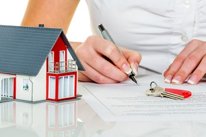 woman signs a contract to purchase a home with a real estate agent knowing What Does Title Insurance Not Cover
