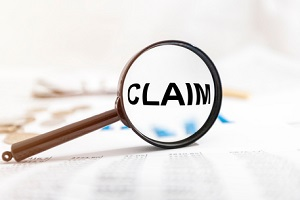 claim word on paper under magnifying glass