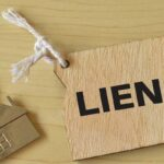 house and label tag written with lien