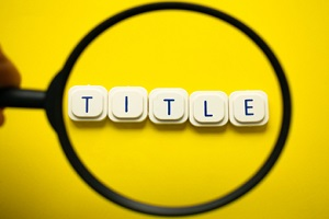magnifying glass looking to the word title