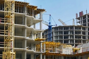 multiple buildings construction in process with title insurance for new construction