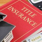 title insurance book with dollars home and calculator